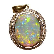large opal and halo diamond pendant 14k gold