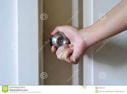 Opening Doorknob stock photo. Image of hand, closeup - 36363136