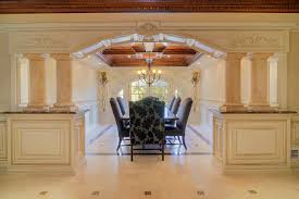formal dining rooms with columns. columns flank entrance to formal dining room rooms with r