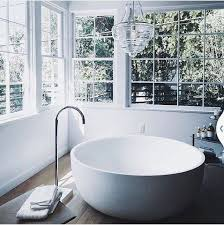 awesome round bathtub crystal clear chandelier master bath for bathroom chandelier