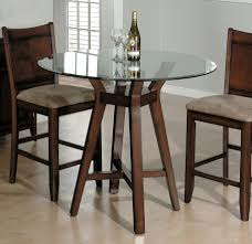 Minimalist Dining Room with Round Glass Top Tall Kitchen Table, Brown  Wooden Stacking Chairs,