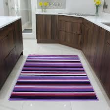 purple bath rugs dark bathroom and towels