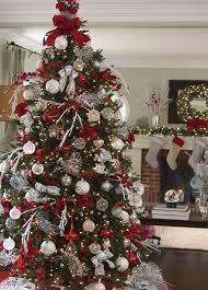 Christmas tree ideas - Tree toppers are a must for an elegant display.  Silver Stretch Net ribbon and loops of Red Velvet Glitter ribbon add the  finishing ...
