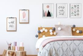 Photos Hang Above Bed
