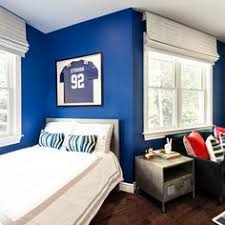 Royal blue bathes the walls of this kid's bedroom, a vibrant backdrop for  treasured collectibles