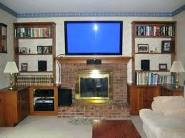 over fireplace tv cabinet over fireplace stand can you hang a on brick wall the best