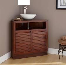 solid wood corner bathroom vanity with white vessel sink and wall mirror