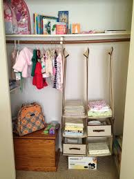 simple baby closet organizers and goldenrod wooden drawers also single hanging clothes area plus hanging pouch and crisscross bag