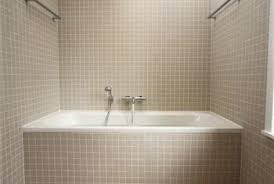 Tiled walls of a bathtub or shower enclosure need a solid backer to support  the tile