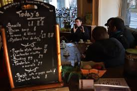 essay examines dual citizenship in this new nationalist era manuel valls at a paris cafeacute note the english language menu offering snails and