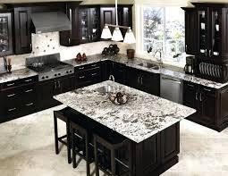 dark cherry cabinets with white granite countertops kitchen