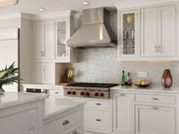 White Glass Tile Backsplash with White Cabinets