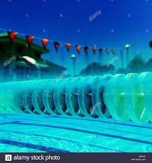 above and below water simultaneous views across 25 meter olympic size outdoor swimming pool from lane