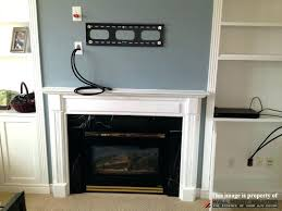 mounting tv above fireplace wall mount installation with wire concealment over figure 1 hide power cords
