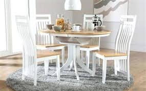 extended round dining table round two tone extending dining table with 4 two tone chairs extending