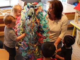 children admire the colors of their developing chandelier with diana hensley head teacher