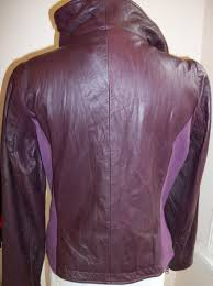 this is a prestine leather jacket crafted from ben sherman the leather is top grade and the deep purple color is a standout it has a high collar which