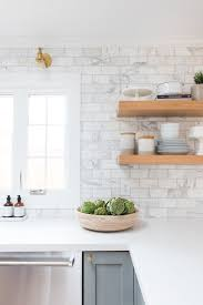 white marble subway tile. Delighful White Pale Grey Cabinets Marble Subway Tile Brass Sconces Floating Shelves In  Wood For White Marble Subway Tile