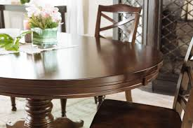 48 to 72 oval pedestal dining table in burnished brown mathis