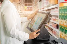 Female Cashier Staff Standing And Working With Pos Or Point