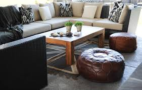 black outdoor sectional with black ikat pillows