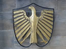 shallow focus photography of brass eagle wall decor