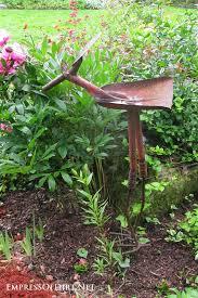 garden art. Rusty Shelf, Birdhouse, Hardware, And Tool Box At The Garden Art
