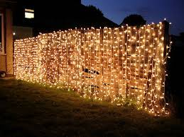 outdoor lighting ideas for parties. curtain lights on fence for nighttime garden party outdoor lighting ideas parties