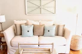 since the pillows on our family room couch were very summery i switched them out with some pillow covers that i found on at pottery barn that were