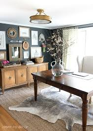 art for home office. home office with layered rugs (jute and cowhide) eclectic art gallery against charcoal for t