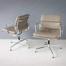 pair of eames ea 208 swivel chairs they are part of the aluminum soft pad