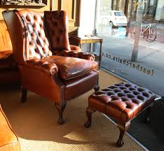 image of brown leather wingback chair