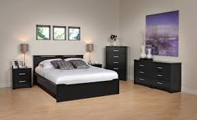 Grey walls with dark wood bedroom furniture
