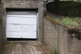 broken garage door repair vs replace