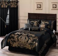A Fancy Bedroom With Black Bed Comforter Set Which Has Gold Schemed Pattern  A Wood Bed