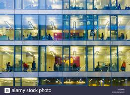 office facade. Facade Of A Modern Office Building With Lights On In The Offices Evening, Munich, Bavaria, Germany