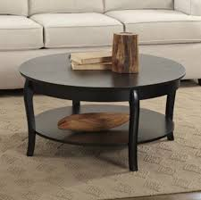 staggering round dark wood coffee table