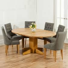 monty solid oak extending round dining table with 6 primly grey chairs 4803
