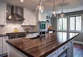 example of a transitional dark wood floor eat in kitchen design in atlanta with recessed