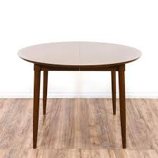 wood extendable dining table walnut modern tables: this dining table is featured in a solid wood with a glossy walnut finish this mid century modern style kitchen table has one extendable leaf