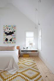 gallery scandinavian design bedroom furniture. Gallery Wall Art And Chic Rug Add Color Pattern To The Stylish Scandinavian Bedroom [Design Design Furniture