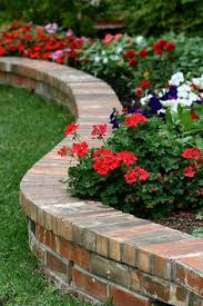brick garden edging. love a raised flower bed bordered by brick. this is what i want when my brick garden edging