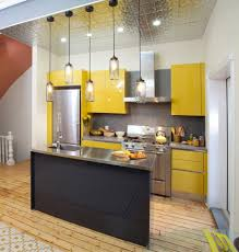 small kitchens designs. 11. Bright Yellows And Metallic Surfaces Small Kitchens Designs