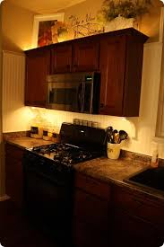 kitchen mood lighting. Accessorizing Above Kitchen Cabinets Enhanced By Lighting Under And Mood