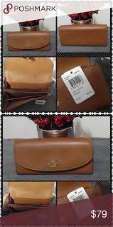 NWT Coach Leather Slim Envelope Wallet NWT Saddle brown Leather Coach  envelope wallet. Large zipper