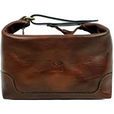 brown leather toiletry bag autumn leaves