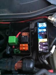 astra mk g driver side indicator stuck in on position the second blue fuse you see is the one i removed and stops the lights from staying on that green square thing on the left is what i m trying to remove