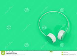 Green Light Wireless Wireless Headphones Isolated On Light Green Background