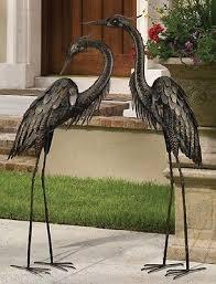 bronze heron pair coastal metal garden