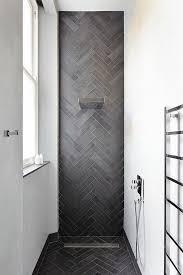 dark herringbone shower tiles